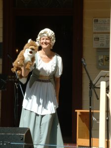 "Lydia in colonial garb with her fox ""Mrs. Macauley"""