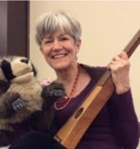 Lydia with dulcimer and Rocco Racoon